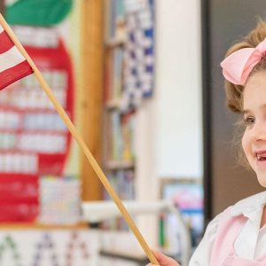 Lower School student leading the pledge of allegiance