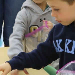 Lower School student serving the community
