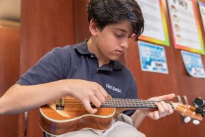 Lower School Boy in Music Class at Oak Knoll