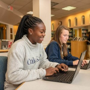 Upper School Student in the Library at Oak Knoll