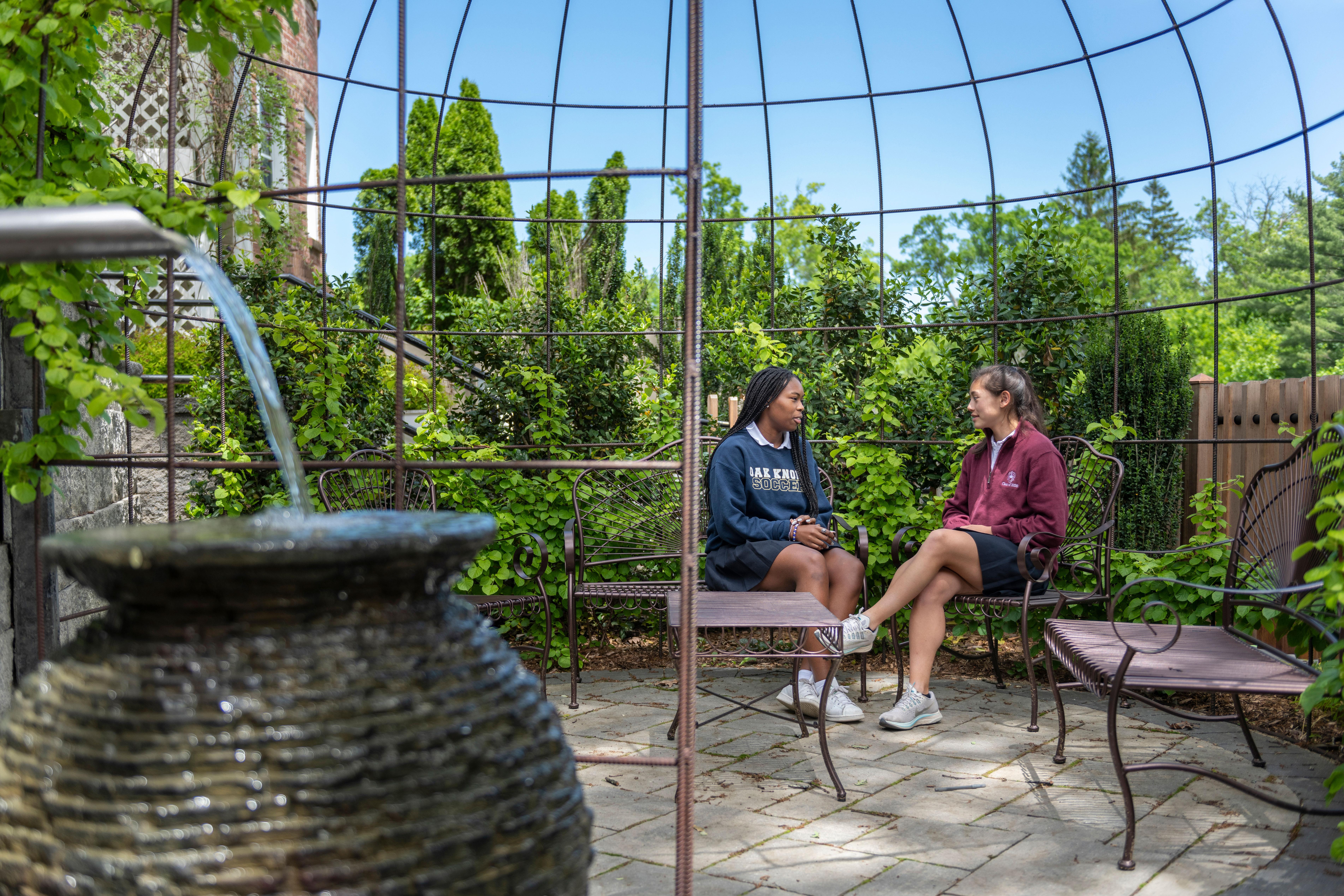 Upper School students in the prayer garden at Oak Knoll