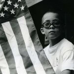 A photo of a boy with the american flag