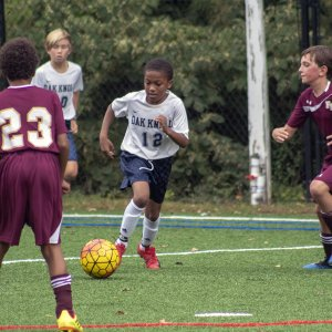Lower School soccer player takes on competition.