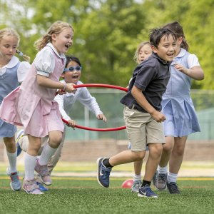 Lower School students play outside during recess.