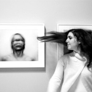 A girl in an art gallery with extreme movement