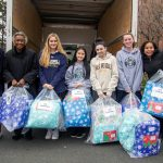 upper school students collecting donations for those less fortunate.