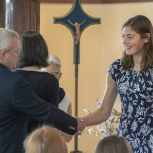 Student shakes hands with Head of School.