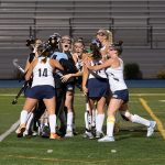 field hockey team celebrates after tournament of champions victory
