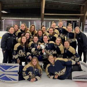 oak knoll school ice hockey team with union county tournament trophy