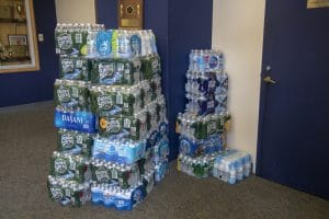 Stacks of bottled water ready for donation