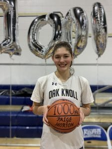 Paige Morton '20 pictured after scoring her 1000th point for oak knoll school