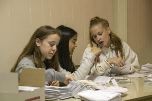 Students organizing mailing and office supplies