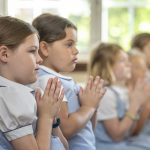 Lower School students during a prayer service at Oak Knoll.