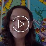Alumna speaks on camera
