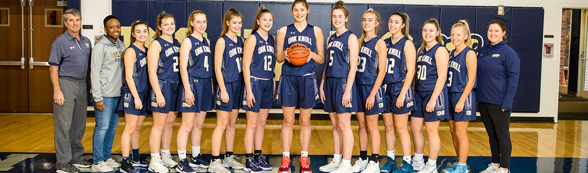 Photo of varsity basketball team and coaching staff.