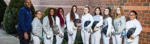 Photo of fencing team and coaching staff.