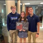 A picture of Haley Meehan and team after raising money for charity.